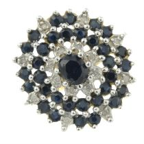 A sapphire and single-cut diamond cluster ring.