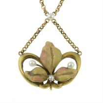 An Art Nouveau enamel and seed pearl necklace.