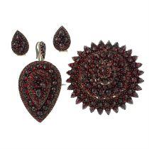 A garnet brooch, pendant and earring set.