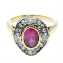 A synthetic ruby and cubic zirconia cluster ring.