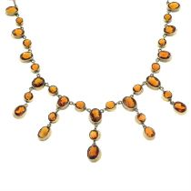 An early 20th century gilt metal citrine necklace.
