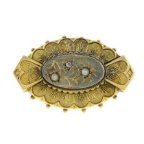 A late 19th century gold split pearl and diamond memorial brooch, with hair to the reverse,