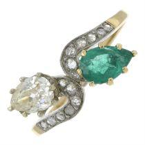 A vari-cut diamond and emerald crossover ring.