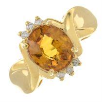 An 18ct gold orange sapphire and brilliant-cut diamond dress ring.