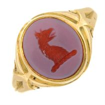 A late Victorian 15ct gold sardonyx seal signet ring of a griffin head.