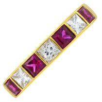 An 18ct gold ruby and diamond band ring.