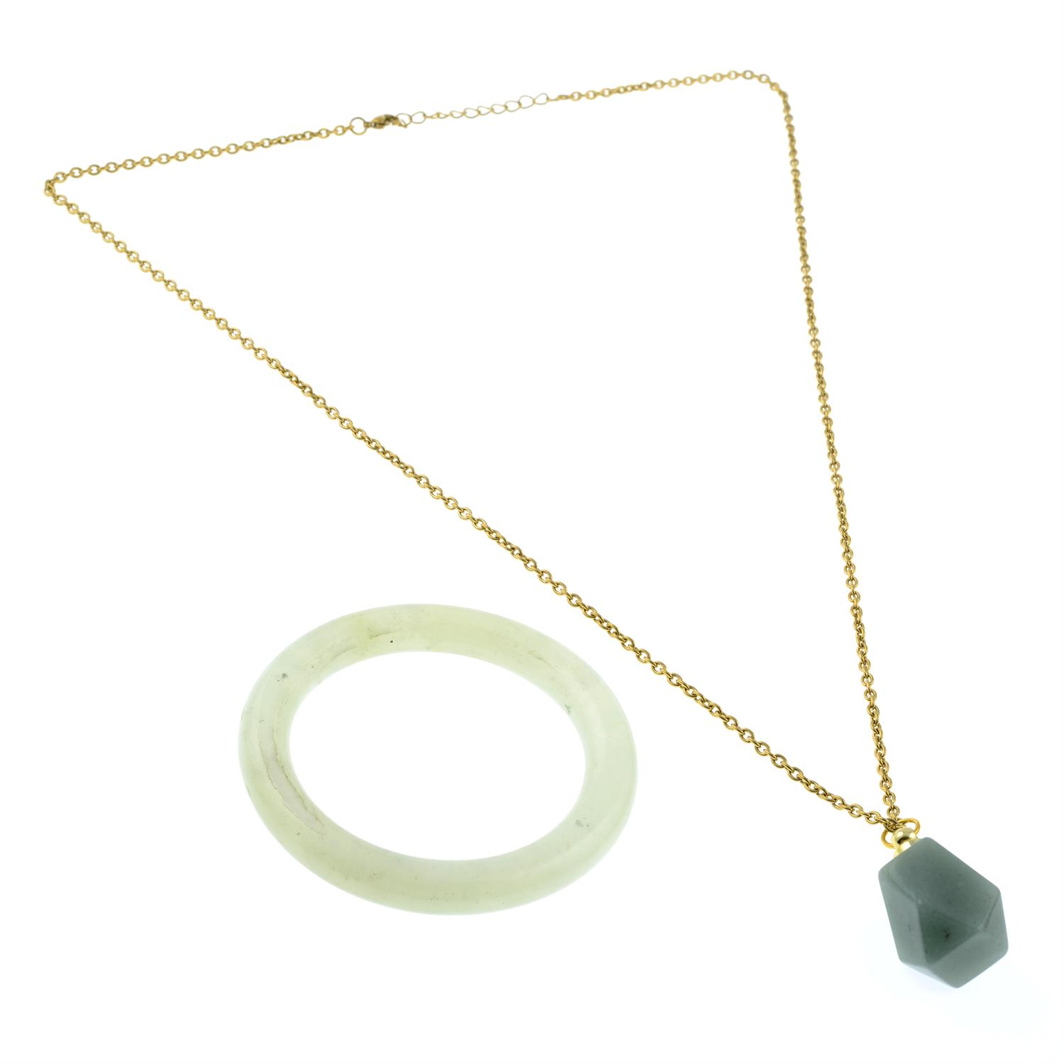 A hardstone bangle and an aventurine snuff bottle pendant. - Image 2 of 2