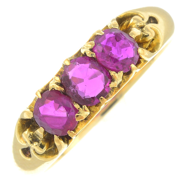 A ruby three-stone ring.