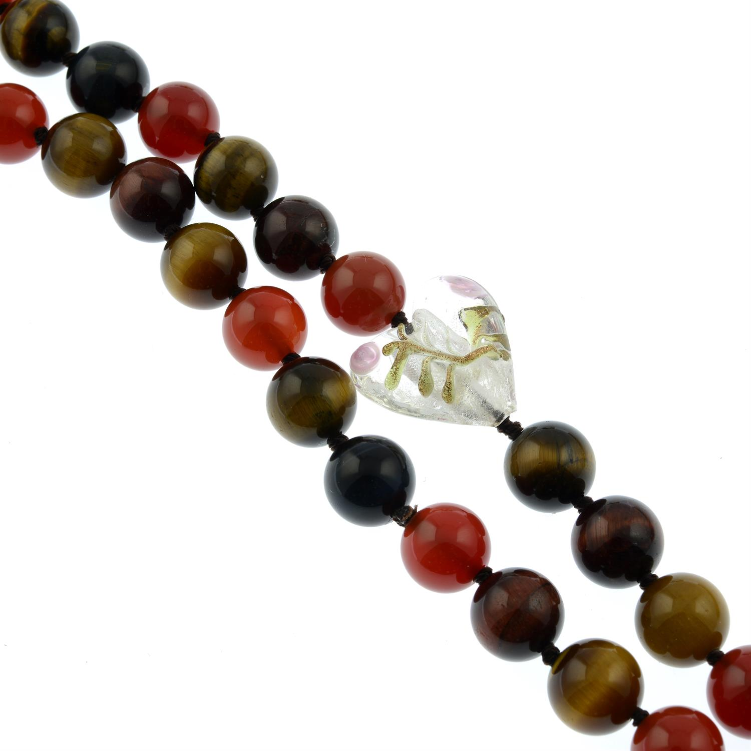 A grooved cuff bangle, a tiger's-eye bead necklace, a black glass necklace and a cultured pearl