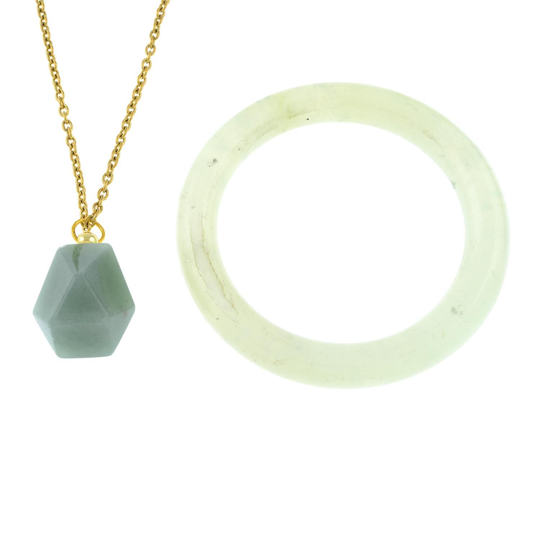 A hardstone bangle and an aventurine snuff bottle pendant.