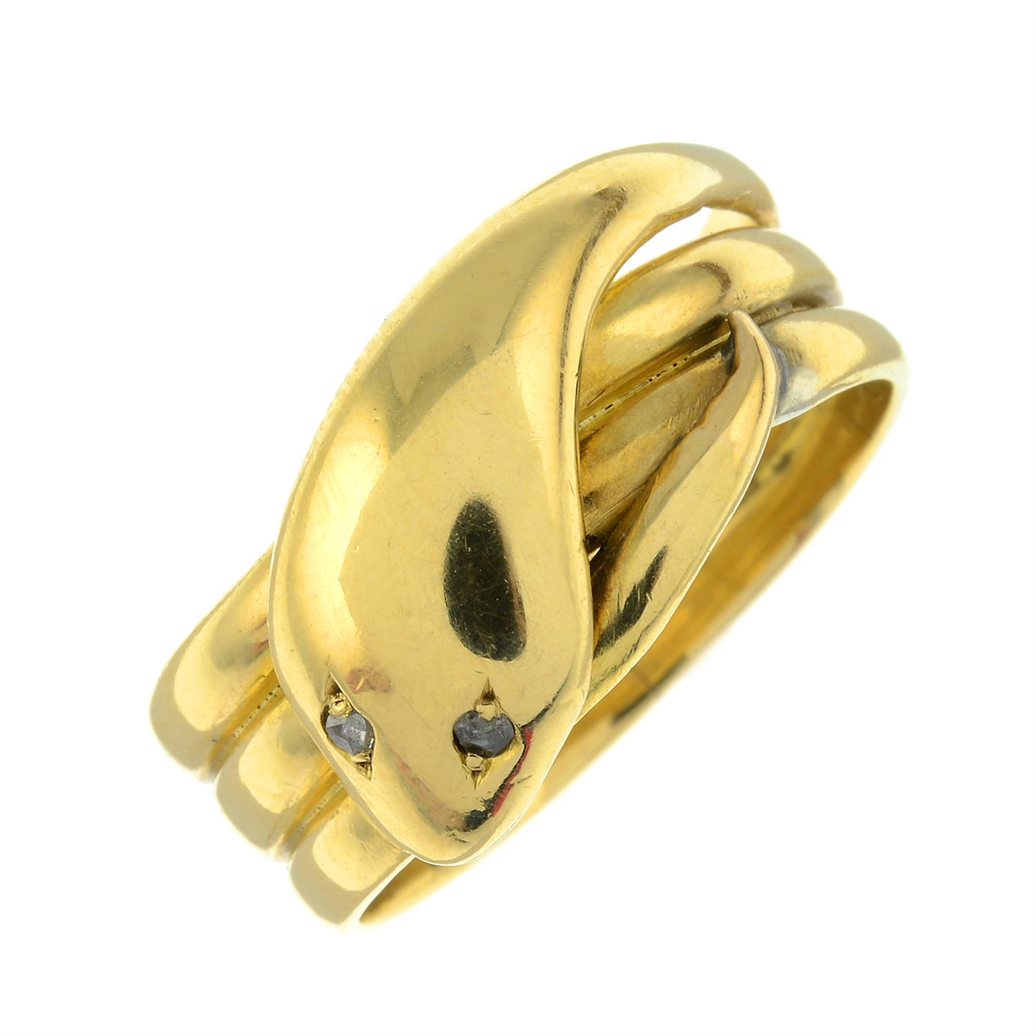 A late Victorian 18ct gold snake ring, with rose-cut diamond eyes.