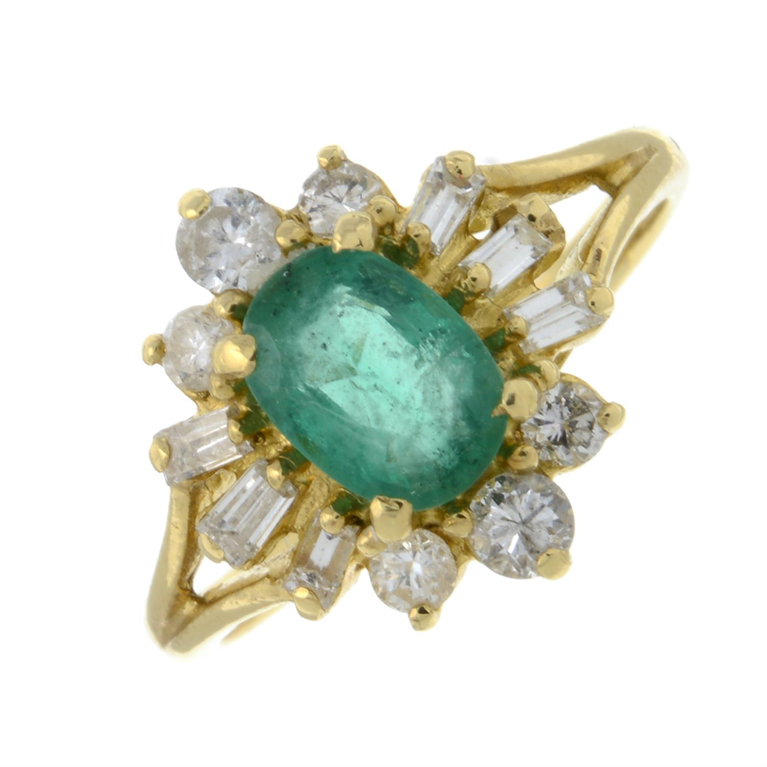 An 18ct gold emerald and vari-cut diamond cluster ring.