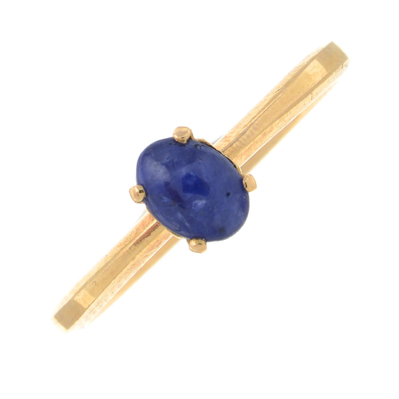 A sapphire cabochon single-stone ring.