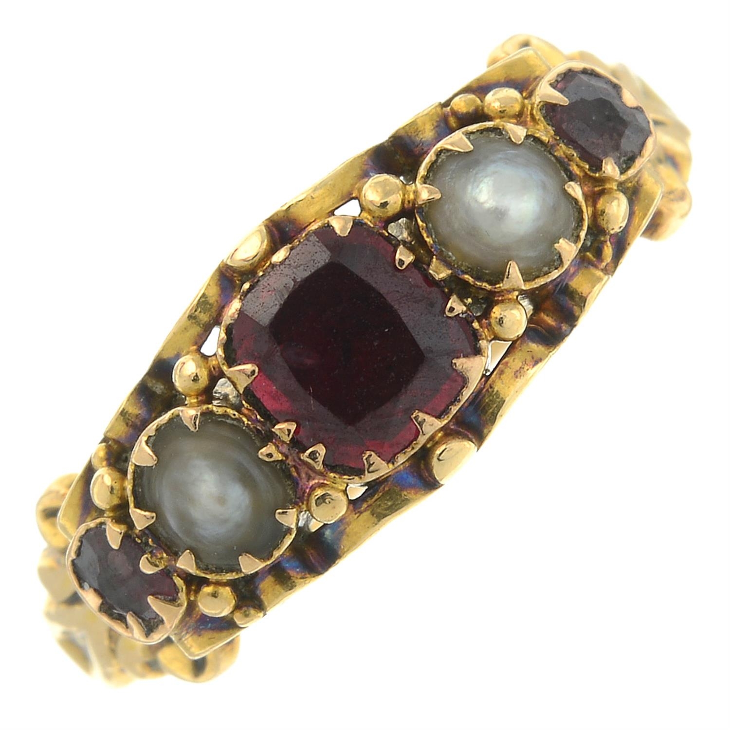 A late Victorian 18ct gold garnet and split pearl five-stone ring.