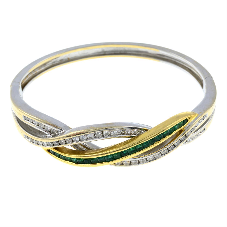 An emerald and diamond hinged bangle.