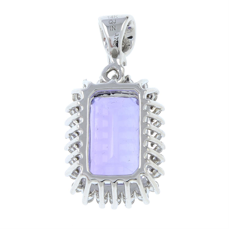 A tanzanite and diamond cluster pendant. - Image 2 of 3