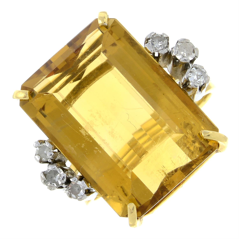 A citrine and diamond dress ring.