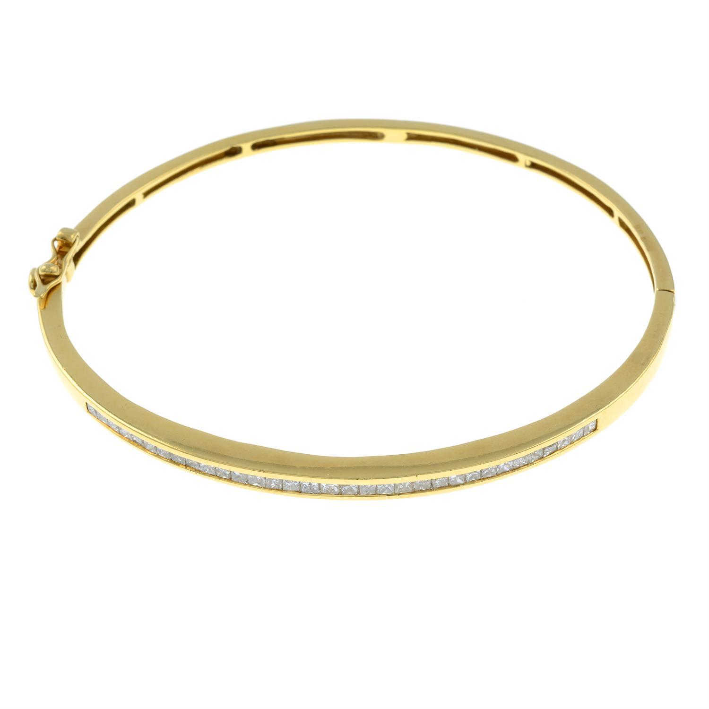 An 18ct gold square-shape diamond hinged bangle.