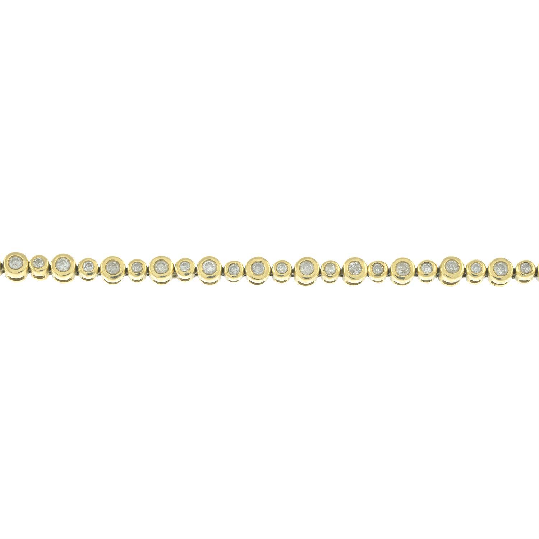 A 9ct gold diamond line bracelet.