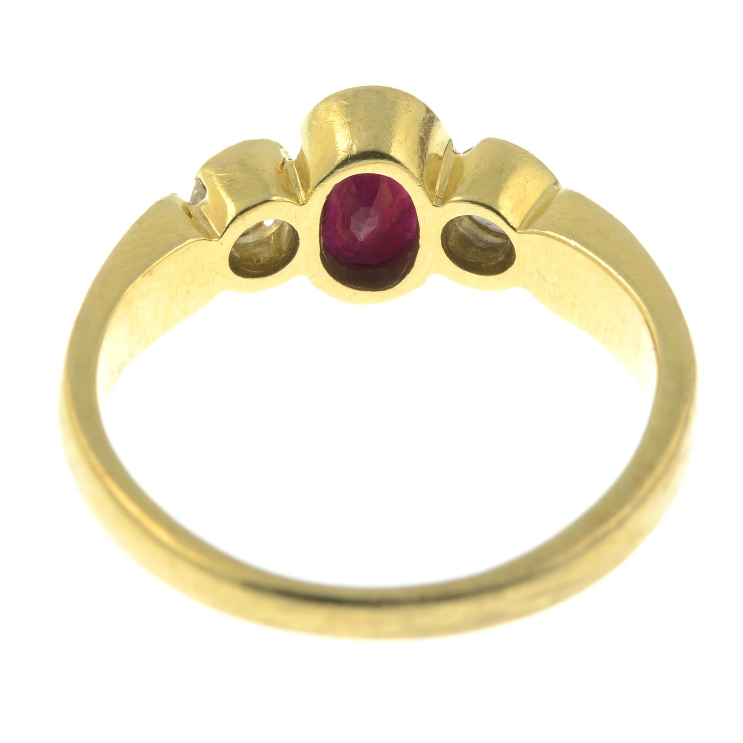 An 18ct gold ruby and diamond three-stone ring. - Image 3 of 3