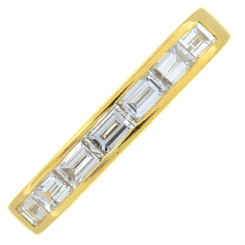 An 18ct gold rectangular-shape diamond half eternity ring.