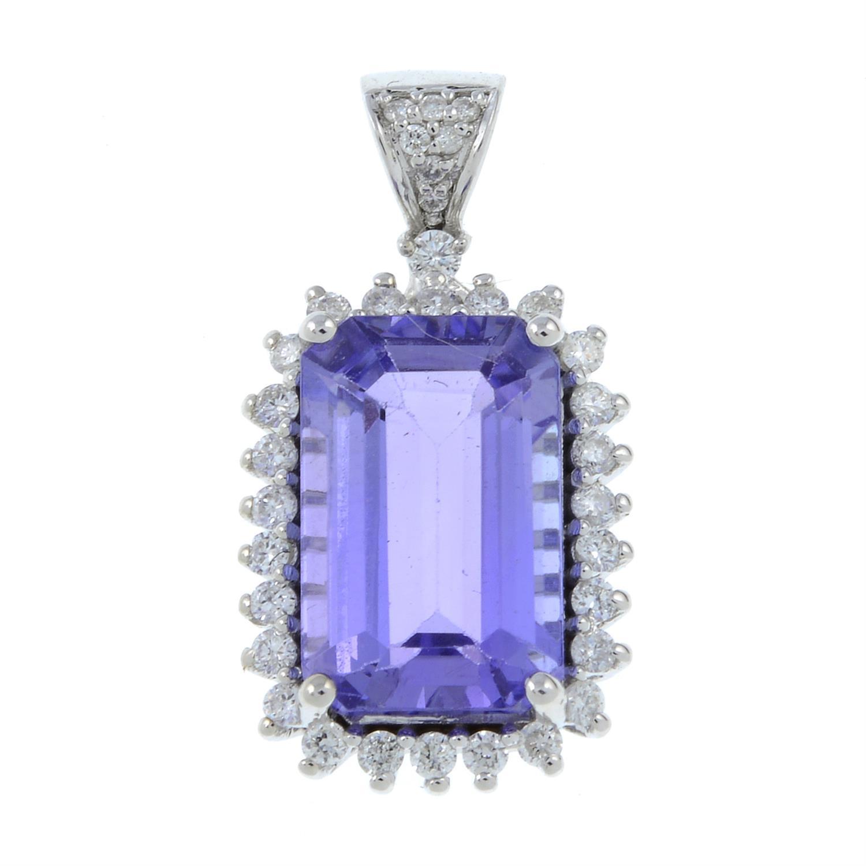 A tanzanite and diamond cluster pendant.