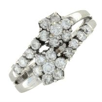 A 9ct gold cubic zirconia cluster crossover ring.