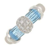 A topaz and pave-set diamond ring.