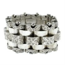 A late Victorian silver engraved bracelet beaded edges.