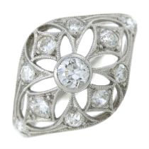 A 1930's platinum diamond dress ring with openwork detail.