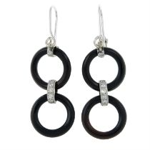 A pair of onyx and diamond drop earrings.