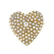 An early 20th century gold old-cut diamond and split pearl heart brooch.