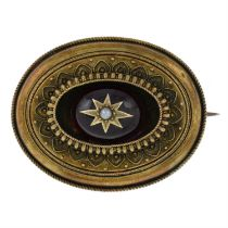 A late 19th century gold, garnet and split pearl brooch.