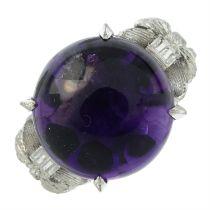 An amethyst cabochon single-stone ring.