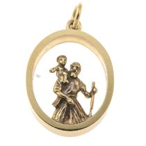 A St. Christopher open work pendant.