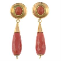 A pair of coral pendant earrings.