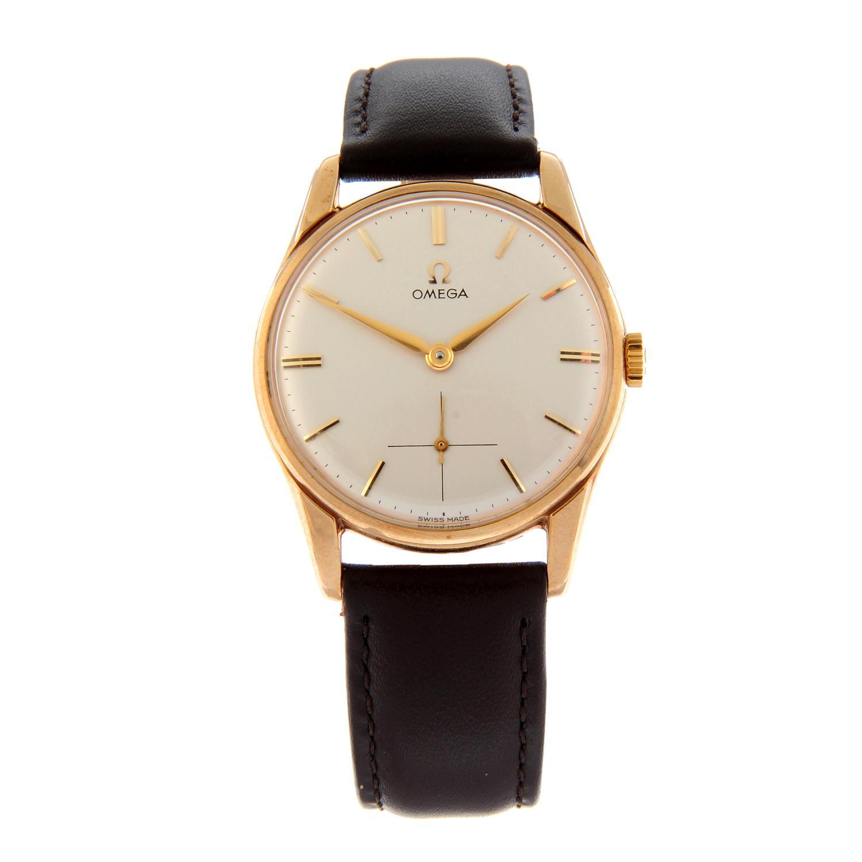 OMEGA - a wrist watch.