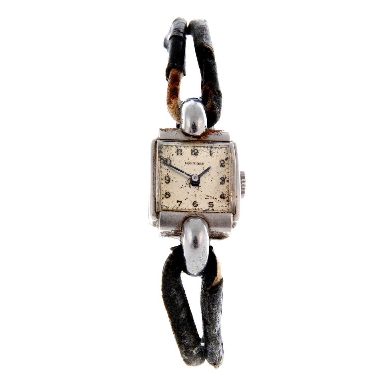 LONGINES - a wrist watch.