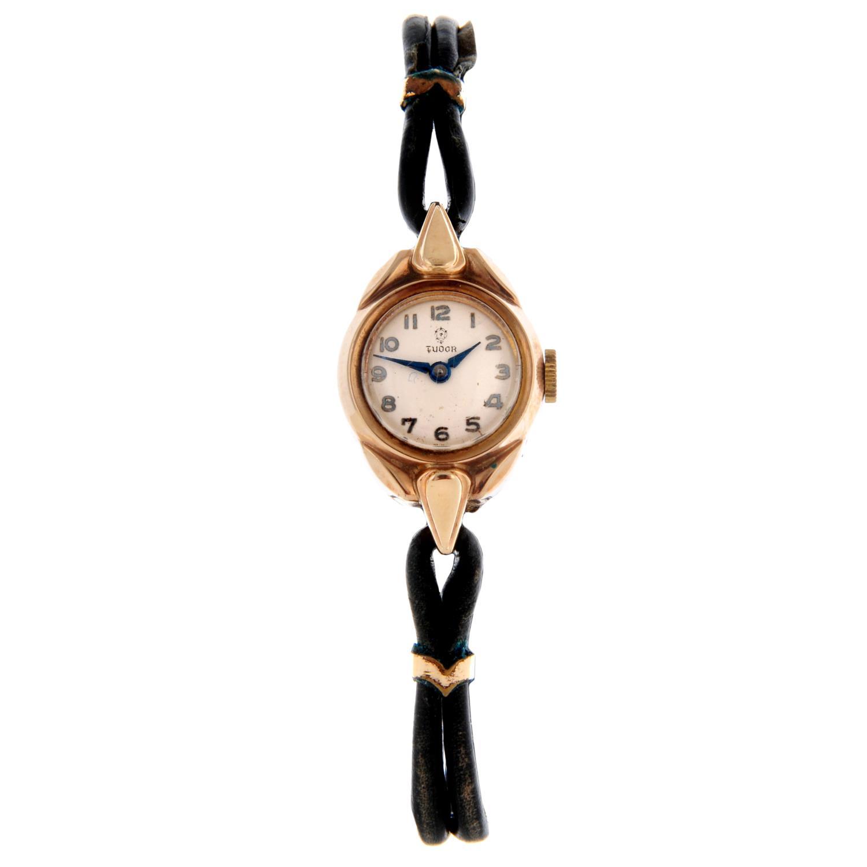 TUDOR - a wrist watch.
