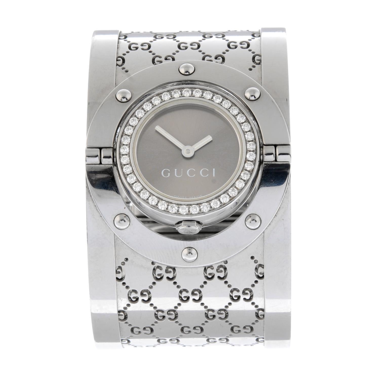 GUCCI - a Twirl bangle watch.