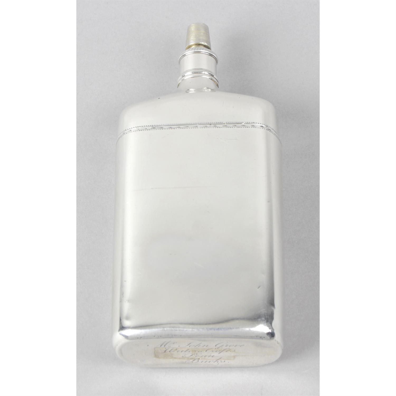 A George III silver hip flask.