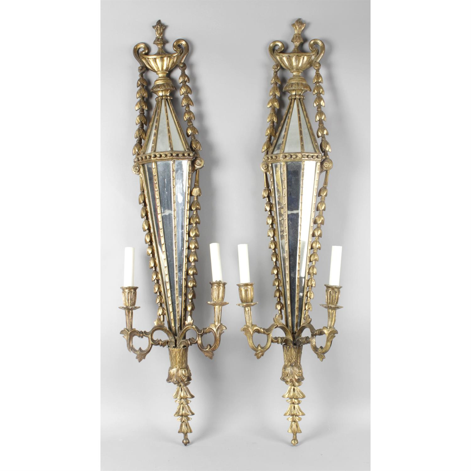 A pair of Giltwood Adam style twin branch wall lights