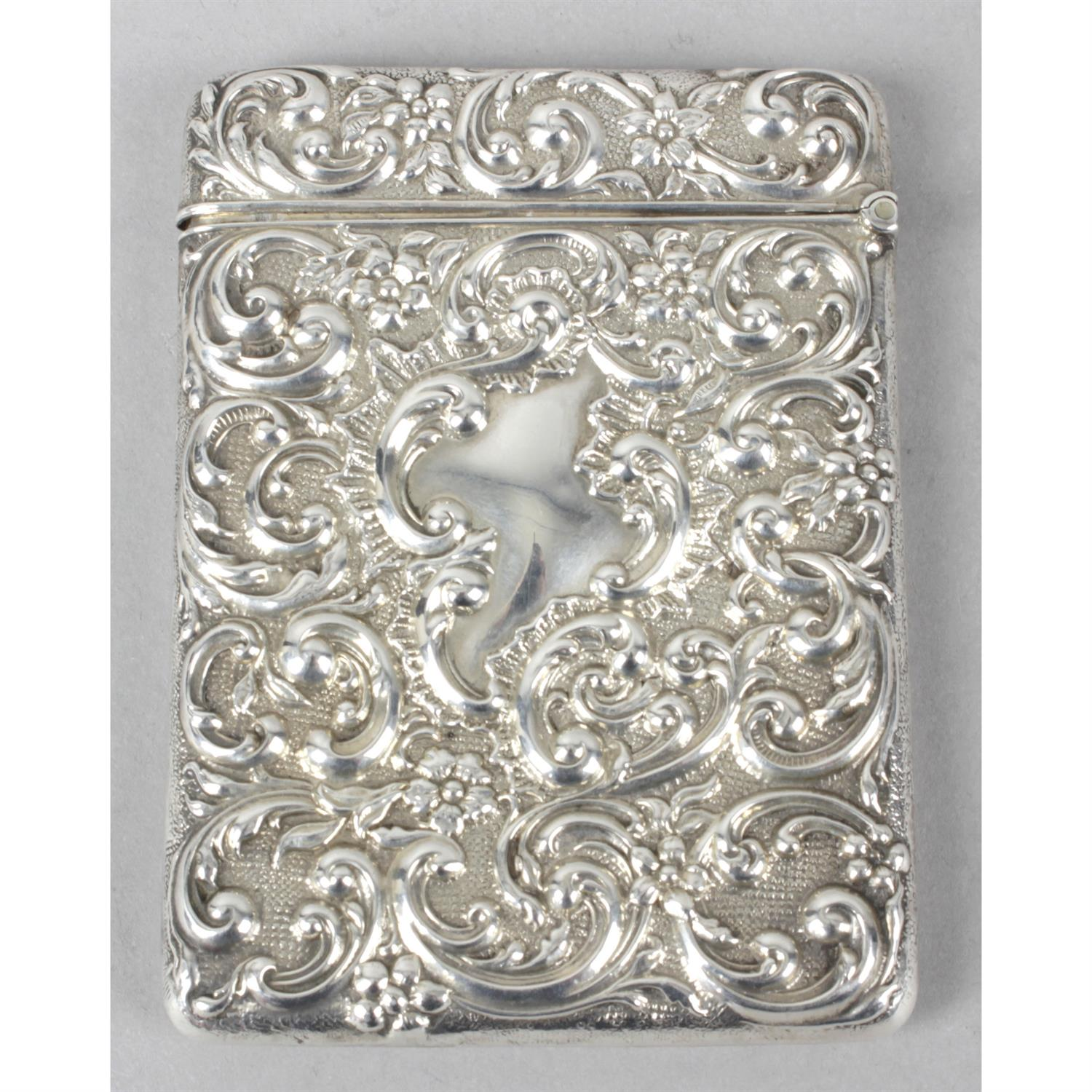 An Edwardian silver card case with repoussé decoration. - Image 2 of 3