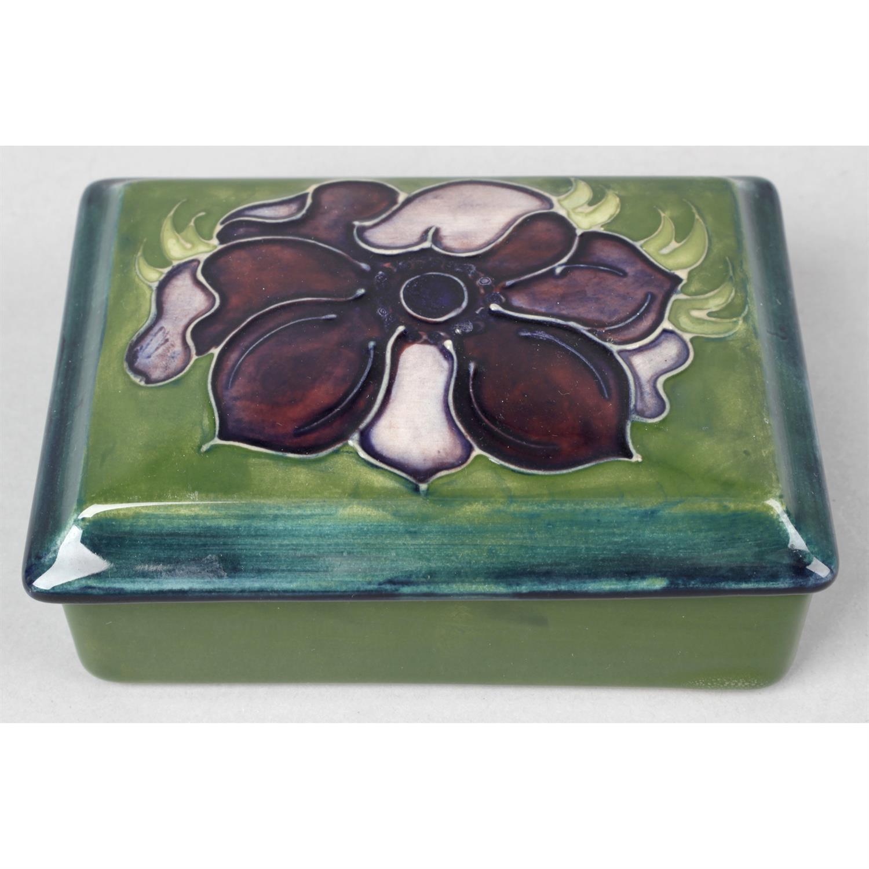 A Moorcroft pottery trinket box.