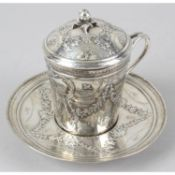 A French silver chocolate cup and saucer.