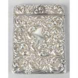 An Edwardian silver card case with repoussé decoration.