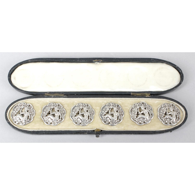 A cased set of six Edwardian Art Nouveau style silver buttons.
