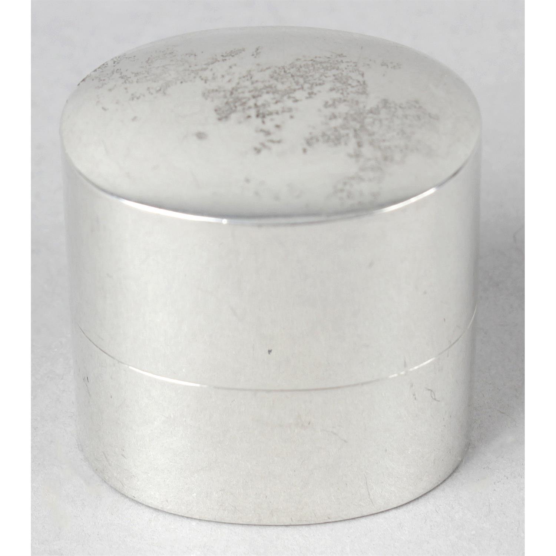 A silver ring box.