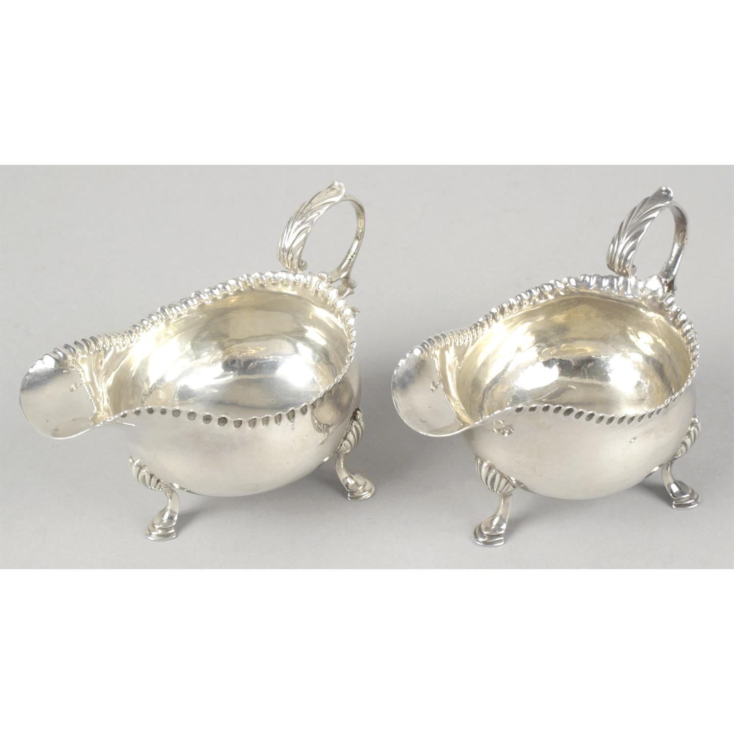 A pair of George III small silver sauce boats by Hester Bateman.