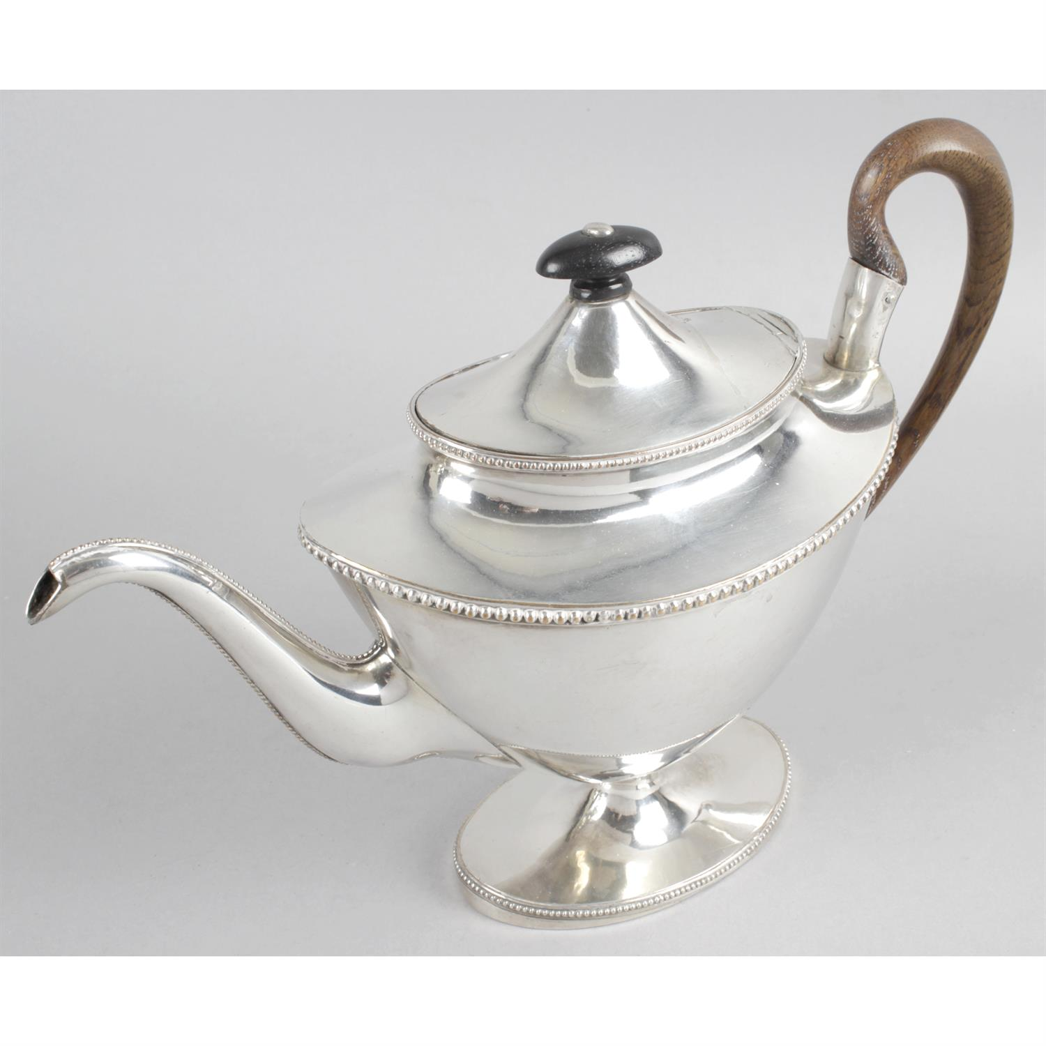 An Old Sheffield plate teapot of vase shape, together with two silver plated coffee pots. (3).